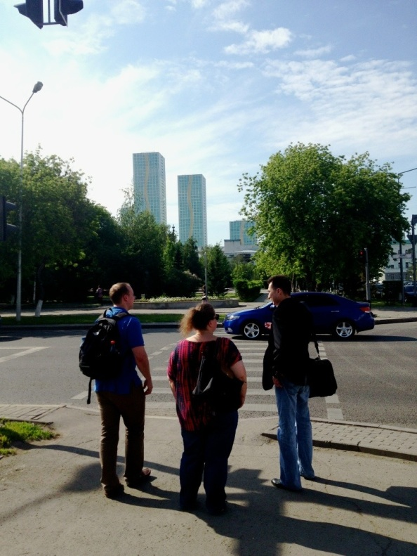 Two Americans and Adil, on the streets of Astana