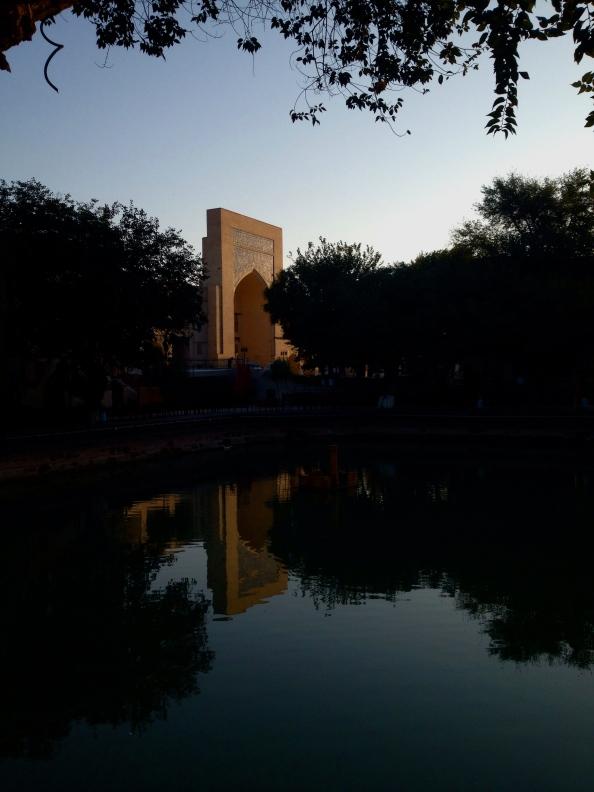 The Kukeldash Medressa in the early morning reflection of the Lyabi-Hauz