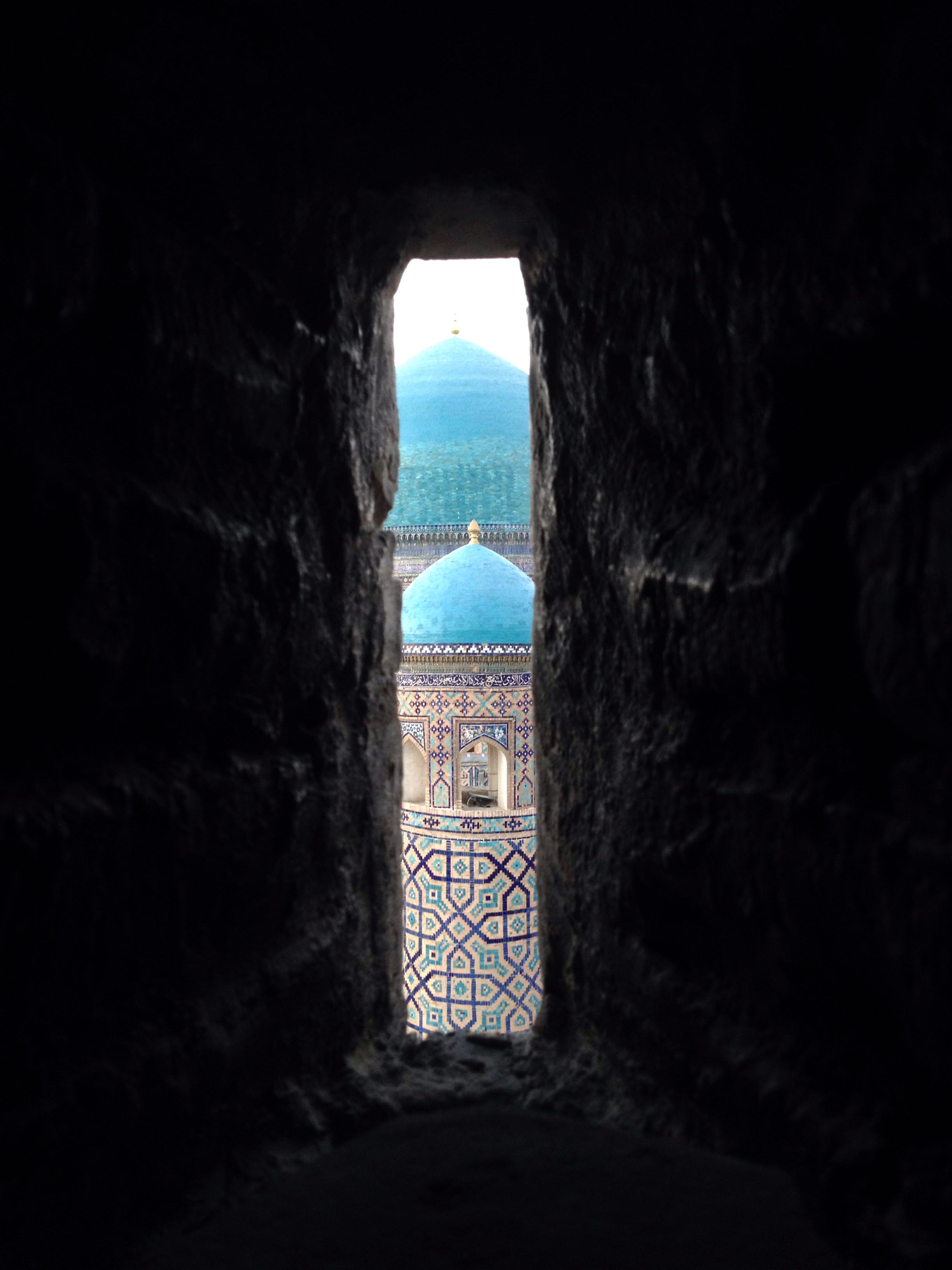 The domes of the Tilla-Kari Medressa from the minaret tower
