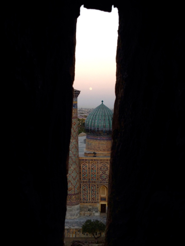 Sher Dor Medressa from the minaret with the moon in the background