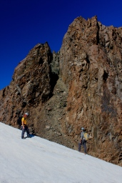 Riley and I evaluating how to get down, with our first objective rising in the background. Photo: Matt