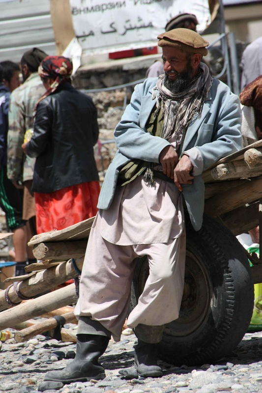 An Afghani man takes  a break from hauling stuff into the bazaar. Photo: Helen