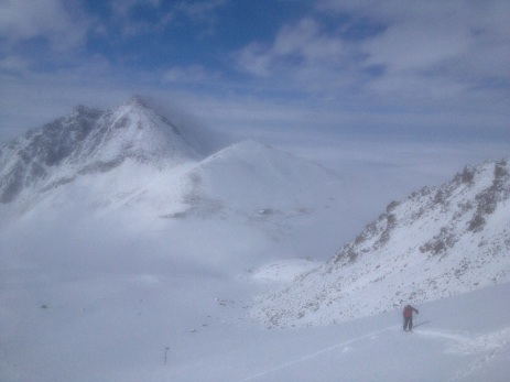Howard touring as the fog temporarily retreated, exposing Big Almaty Peak in the background