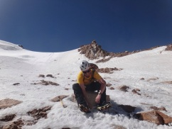 Clipping on the crampons to my shiny new boots. Photo: Chris