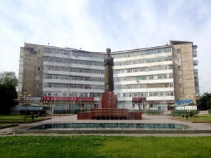 Statue and Building in Osh