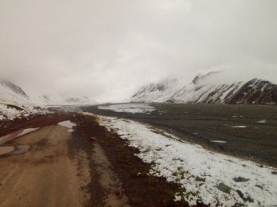 The road at moraine in the uncontrolled border zone between Kyrgyzstan and Tajikistan. It is apparent neither side takes responsibility for maintaining the road.
