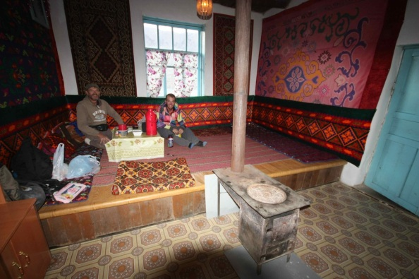 Svend, the stove, and I in the Erali Guesthouse. Simply the best place to stay in Eastern Tajikistan