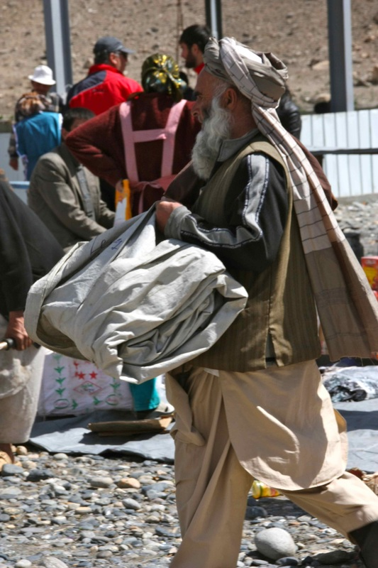 "An Afghanistani man carries his ""shop"" in the bazaar. Photo: Helen"