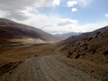 The Road and the Pamir River. Any views on the other side of the river are looking at Afghanistan. It looks a lot like Tajikistan.